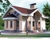 Двухэтажный дом из кирпича в стиле модерн с эркером и пилонами