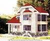 Трёхэтажный дом из кирпича с разноуровневой крышей